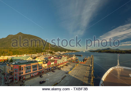 Sept 17, 2018 - Ketchikan, AK: Elevated view of emptying dock and shops on Spruce Mill Way at sunset from above cruise ship bow. - Stock Image