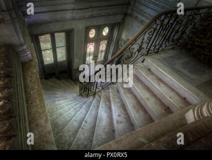 High angle view of a staircase in an abandoned castle in France. - Stock Image