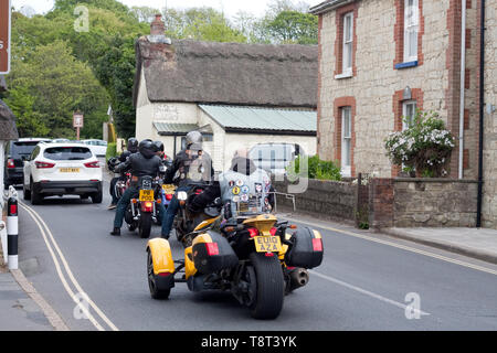 Bikers on the main street in Godshill, Isle of Wight - Stock Image