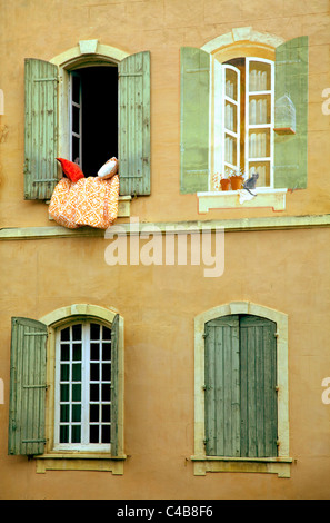 Arles; Bouches du Rhone, France; Detail of a partly painted house facade with false windows - Stock Image