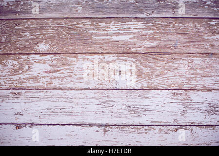 Vintage weathered shabby white painted wood texture as background. - Stock Image