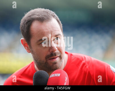 Windsor Park, Belfast, Northern Ireland. 14th Apr, 2019. 'My Tribute' Celebrity Football Match; Danny Dyer of Jake's United XI gives an interview prior to kickoff Credit: Action Plus Sports/Alamy Live News - Stock Image