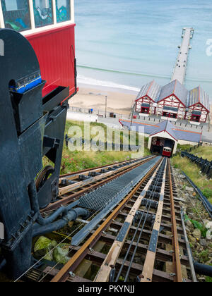 View from the top station of the Saltburn Hydraulic Funicular cliff lift looking down to the pier with new tracks after refurbishment in 2018 - Stock Image