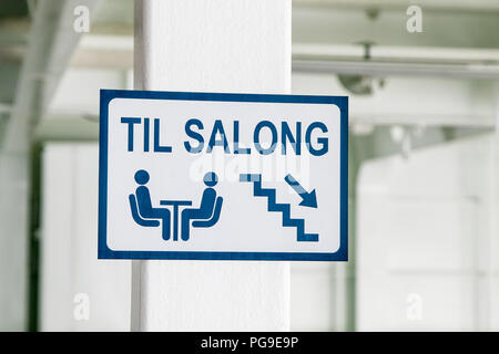 Sign indicating the way to the passenger cabin on board a Norwegian ferry. - Stock Image