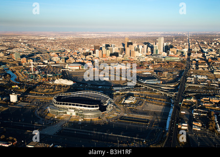 Aerial cityscape of urban Denver Colorado with Mile High stadium in foreground - Stock Image