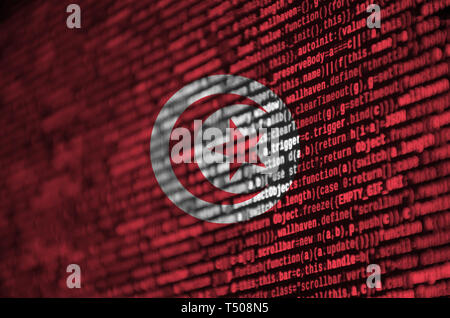 Tunisia flag  is depicted on the screen with the program code. The concept of modern technology and site development. - Stock Image