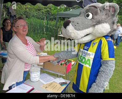 Warrington Wolves Mascot Wolfie at Grappenhall Walking Day, Community Library stall, Warrington, Cheshire,England,UK - Stock Image