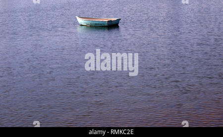 Lone dinghy on the Tamar River, Beauty Point, Tasmania, Australia. No PR - Stock Image