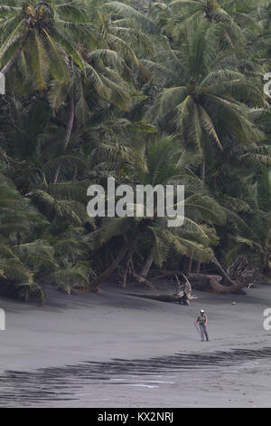 Hiker on beach Corcovado national Park Costa Rica Osa Peninsula - Stock Image