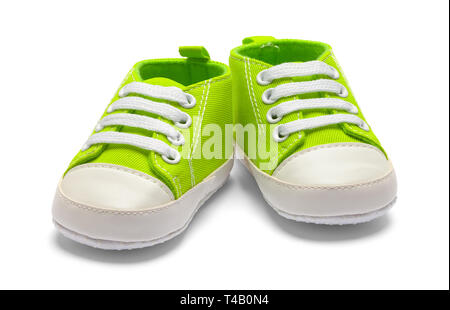 Pair of Green Baby Sneakers Isolated on White Background. - Stock Image