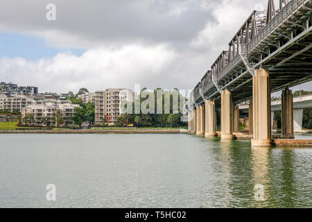 Iron Cove bridge built in the 19th century links the Sydney suburbs of Rozelle and Drummoyne, Sydney,New South Wales,Australia - Stock Image
