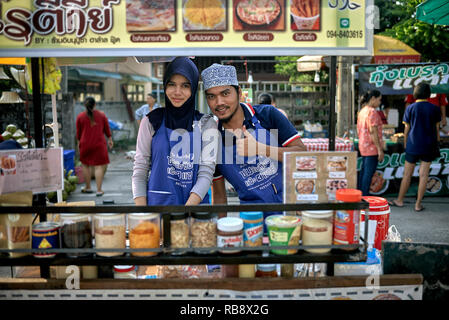 Muslim street food vendors. Young Muslim couple, Thailand, Southeast Asia - Stock Image