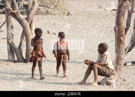 Africa, Namibia, Opuwo. Three Himba boys. Credit as: Wendy Kaveney / Jaynes Gallery / DanitaDelimont.com - Stock Image