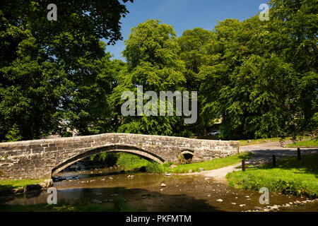 UK, Yorkshire, Wharfedale, Linton in Craven, ford and old packhorse bridge, over Linton Beck - Stock Image