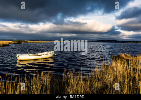Ardara, County Donegal, Ireland. 30th December 2018. Dramatic light on the north-west coast as heavy stormclouds move to cover earlier sunny spells. Credit: Richard Wayman/Alamy Live News - Stock Image
