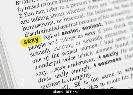 Highlighted English word 'sexy' and its definition at the dictionary. - Stock Image