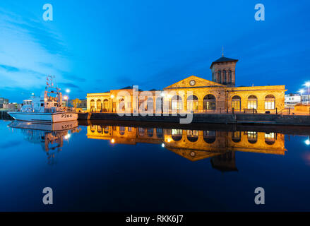 Night view of Illuminated Forth Ports building reflected in dock at night in Leith, Edinburgh, Scotland, UK - Stock Image