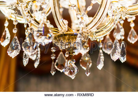 Close up of a decorative lamp with hanging crystals. - Stock Image