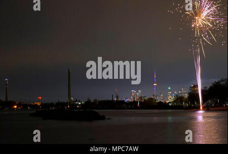 Fireworks on the beach of Ashbridge Bay by partying people Credit: CharlineXia/Alamy Live News - Stock Image