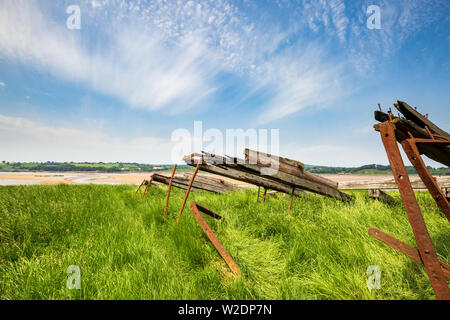 The remains of a Schooner beached on the banks of the River Severn, part of the Purton Hulks, Gloucestershire - Stock Image