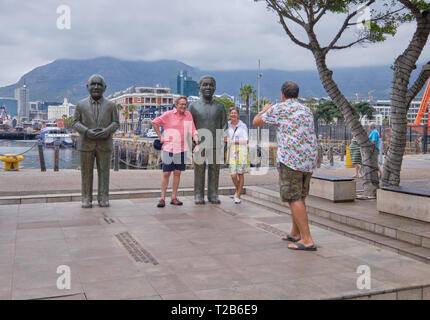 Tourists posing for picture next to Nelson Mandela statue, Nobel Square, Victoria & Alfred waterfront, Cape Town, South Africa, - Stock Image