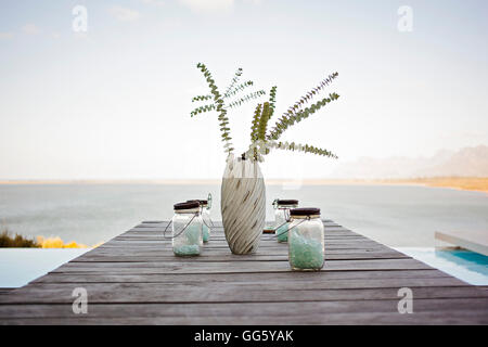 Vase on table in resort at lakeside - Stock Image