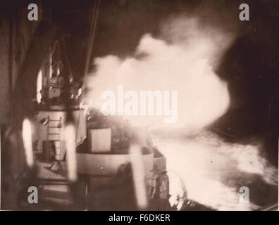 """710. HMS Norfolk attacks. The flash of the firing of the 8"""" guns. Action off the coast of Norway 12th Jan 1945. - Stock Image"""