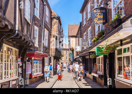 York  Shambles Tourists walking down the Shambles the narrow street of half-timbered old medieval buildings York Yorkshire England UK, GB Europe - Stock Image