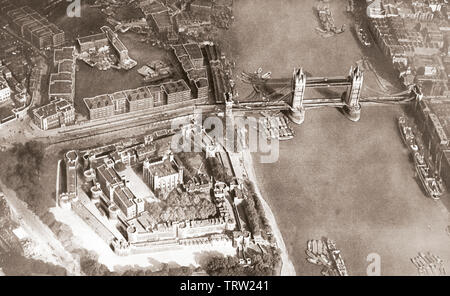 Aerial view of the river Thames and Tower Bridge, London, England, seen here c. 1935. - Stock Image