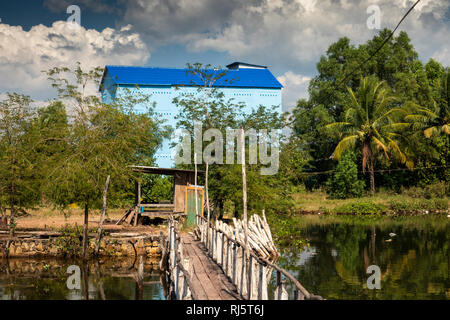 Cambodia, Preah Koh Kong, Krong Khemara Phoumin, building to house birds nest soup swiftlets beside waterway - Stock Image