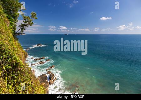 Scenic Landscape view of Pacific Ocean Coastline from Sendero Punta Catedral Hiking Trail in Manuel Antonio National Park Costa Rica - Stock Image