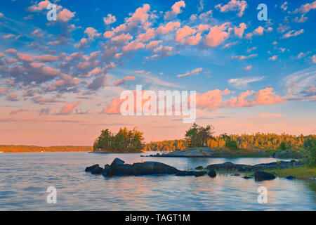 Clouds at sunrise on Lake of the Woods Sioux Narrows Provincial PArk Ontario Canada - Stock Image