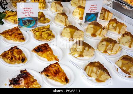 Fort Lauderdale Ft. Florida Las Olas Boulevard Las Olas Art Fair festival food dessert apple tart bread pudding sweets plates si - Stock Image
