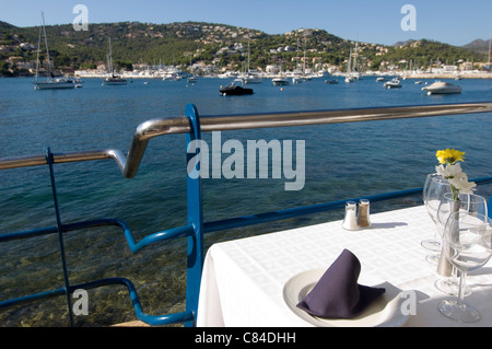 Puerto d'Andratx, the end of the day, restaurant table, harbourside - Stock Image