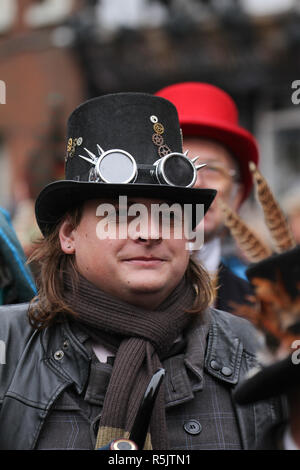 Rochester, Kent, UK. 1st December 2018: A parade participant in Steampunk costume takes part in the main parade. Hundreds of people attended the Dickensian Festival in Rochester on 1 December 2018. The festival's main parade has participants in Victorian period costume from the Dickensian age. The town and area was the setting of many of Charles Dickens novels and is the setting to two annual festivals in his honor. Photos: David Mbiyu/ Alamy Live News - Stock Image