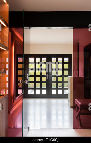 Coloured glass door by entrance hall - Stock Image