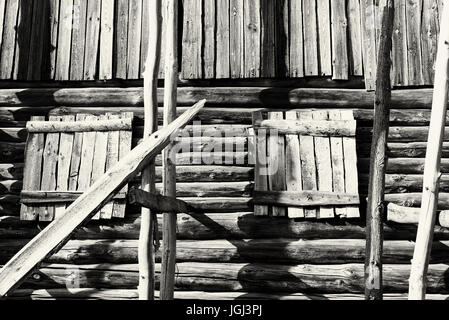 Old dry timber from an old log house. The wooden construction shows signs of age and weathering - Stock Image