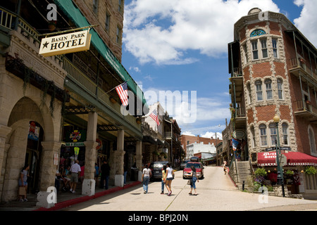Visitors shopping in historic downtown Eureka Springs, Ark. - Stock Image
