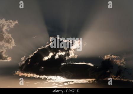 Dramatic crepuscular sun rays at sunrise - Stock Image