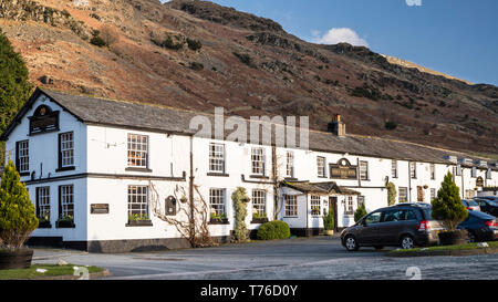English lake district. The King's Head Hotel frontage with a mountain backdrop. - Stock Image