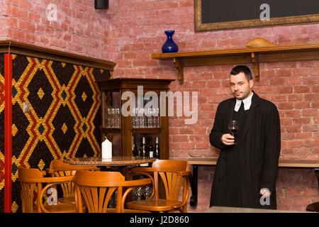 Czech Republic, Prague. Monk with wine at National Wine Bank. Credit as: Wendy Kaveney / Jaynes Gallery / DanitaDelimont.com - Stock Image