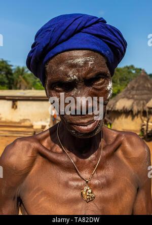 Dan tribe senior woman dancing during a ceremony, Bafing, Gboni, Ivory Coast - Stock Image
