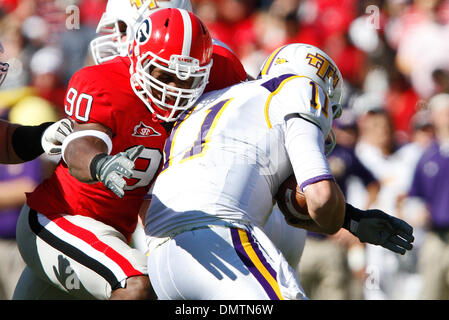 Georgia freshman defensive end Montez Robinson (90) sacks Tennessee Tech quarterback Lee Sweeney (11) in the game against Tennessee Tech at Sanford Stadium at the University of Georgia in Athens, Ga., on Saturday, November 7, 2009. Georgia won the matchup with a 38-0 shutout. (Credit Image: © Daniel Shirey/Southcreek Global/ZUMApress.com) - Stock Image