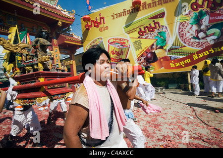 Thailand, Ko Phuket, Phuket.  Devotees carry a religious idol on a palanquin through Phuket Town - Stock Image