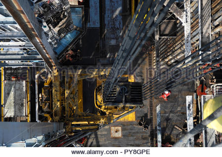 View directly above worker on offshore oil platform - Stock Image