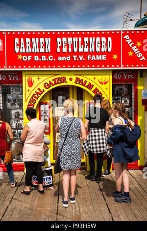 UK, England, Lancashire, Blackpool, South Pier, visitors queueing outside Carmen Petulengro Palmist and Clairvoyant - Stock Image