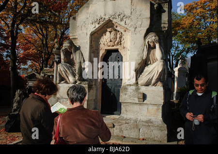 Paris, France - Senior Couple Visiting Urban Park, Pere Lachaise Cemetery, French Monument - Stock Image