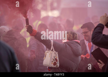 'We want our country back', protesters gathered in Parliament Square outside the Houses of Parliament in Westminster. Female with handbag and flare - Stock Image