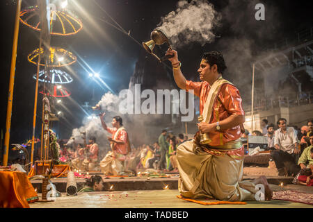 A Hindu ceremony in Varanasi at night next to the Ganges river. - Stock Image