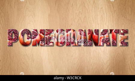 Pomegranate word covered with Pomegranate fruit on a kitchen cutting board - Stock Image